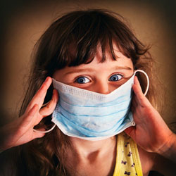 Girl wearing flu mask